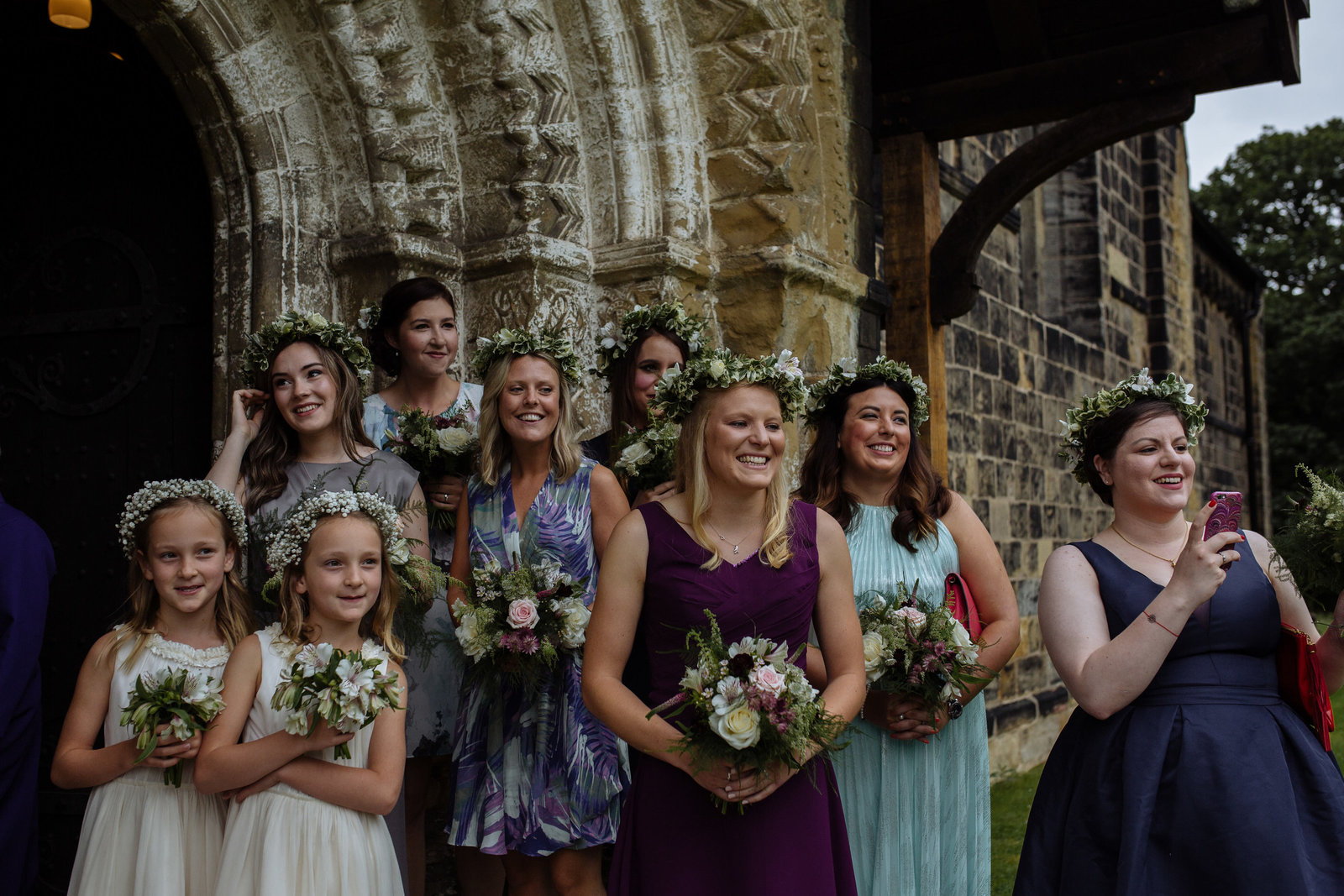 Bridesmaids at Adel Church, Leeds. Yorkshire documentary wedding photographer