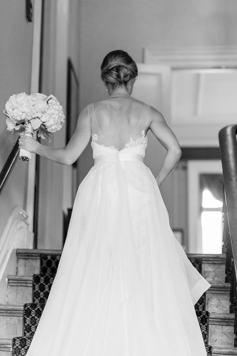 Bride walks up the stairs, John Rutledge House Inn, Charleston Wedding Photographer.