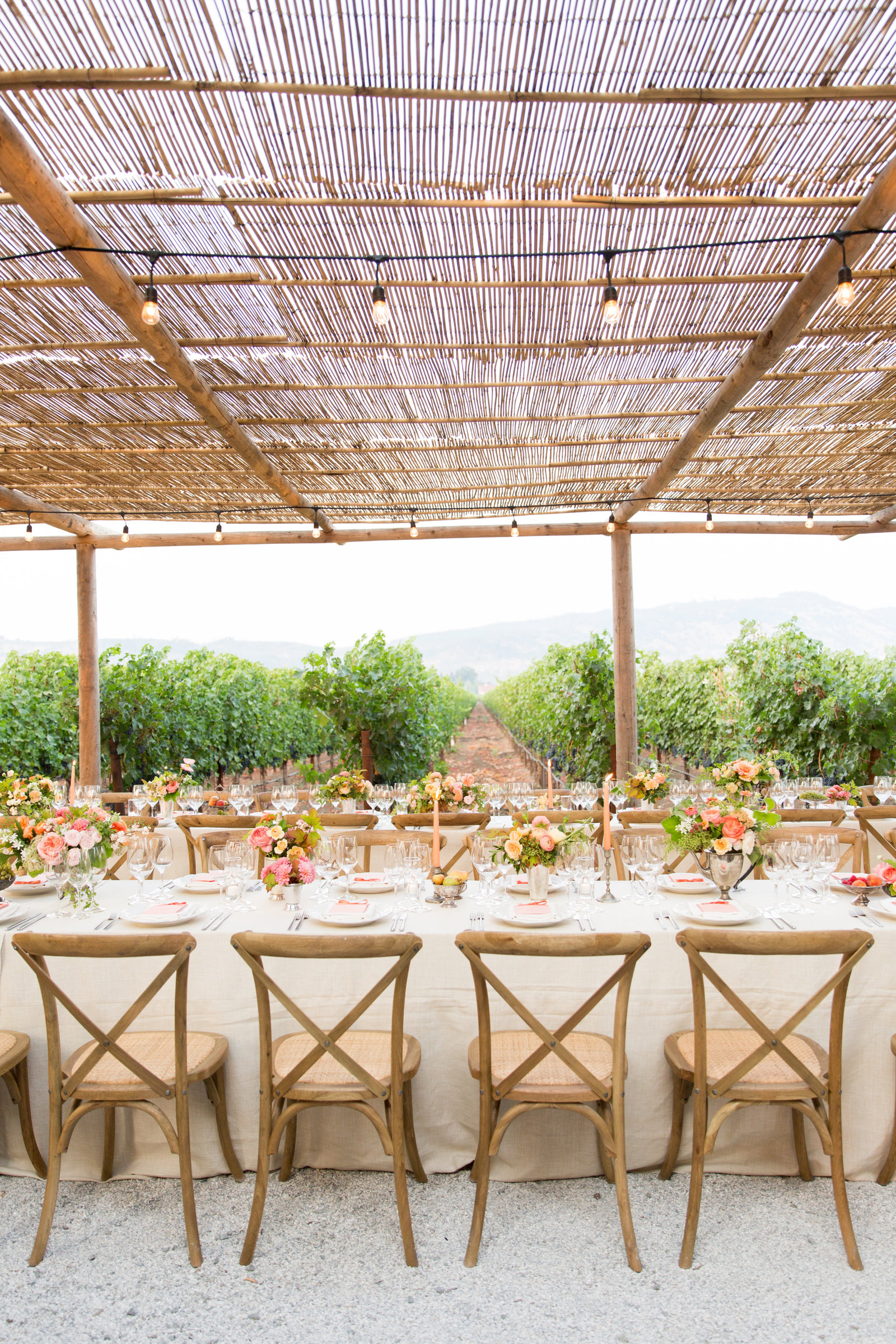 Wedding welcome dinner by Jenny Schneider Events at Round Pond Estate in Napa Valley, California. Photo by Eric Kelley Photography.