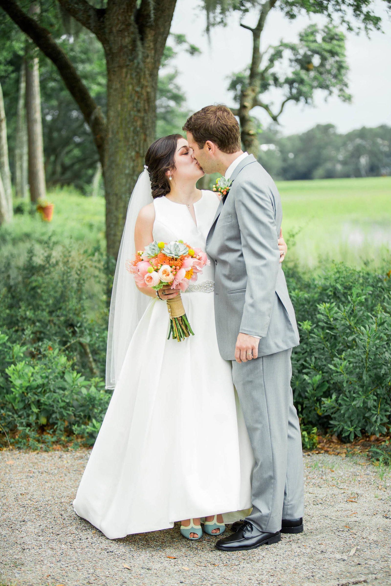 Bride and groom stand by the marsh, I'on Creek Club, Mt Pleasant, South Carolina