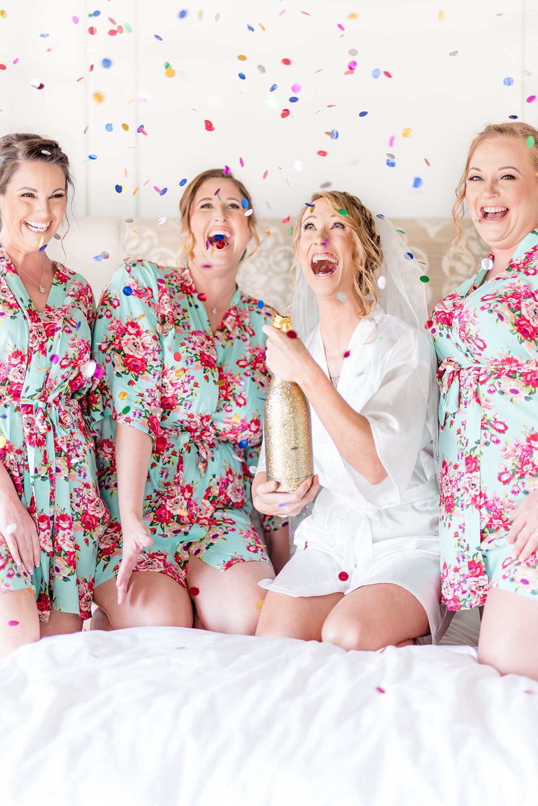 Bride and bridesmaids pop confetti.