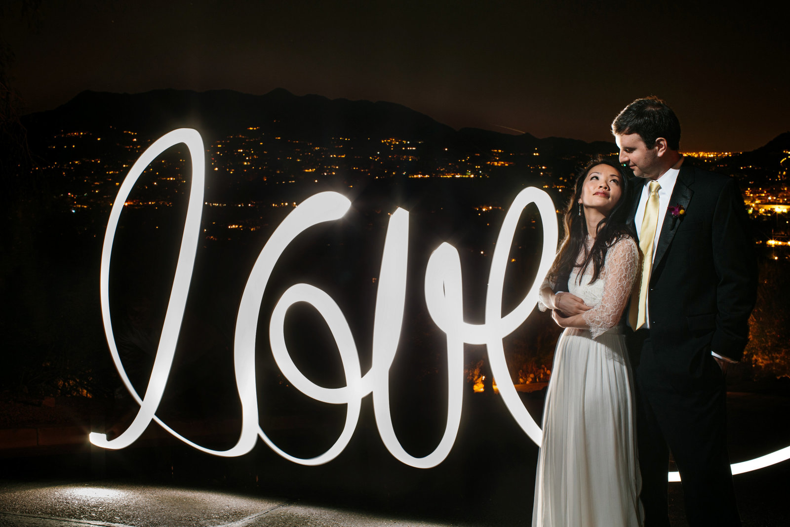 Wedding Couple with light painting overlooking the city