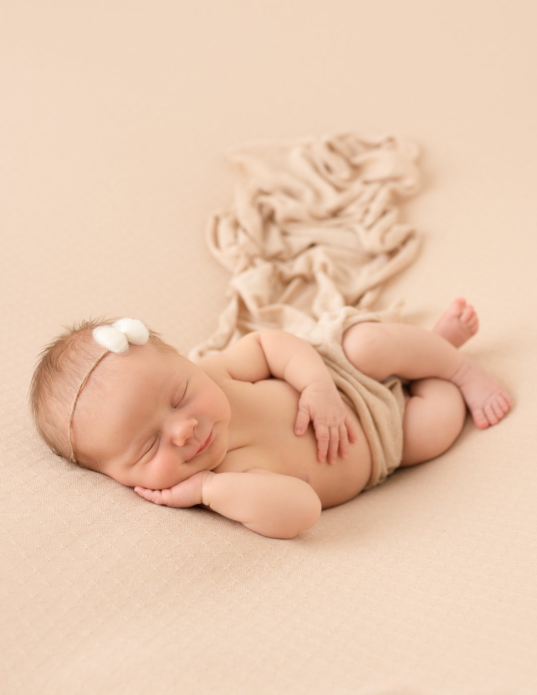 Gorgeous baby girl posed in our Rochester, Ny studio.