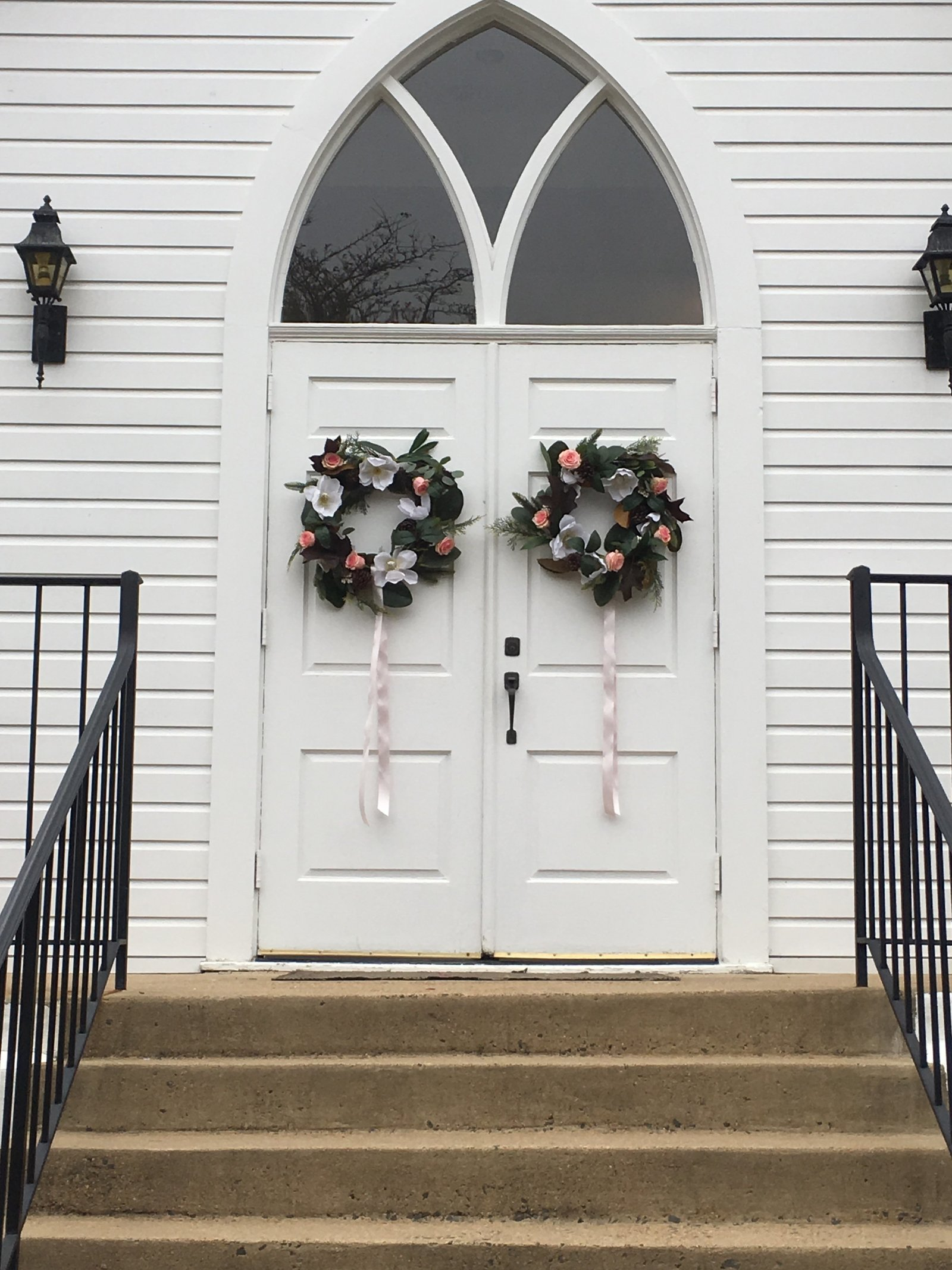 Rustic wreaths for doors of country chapel