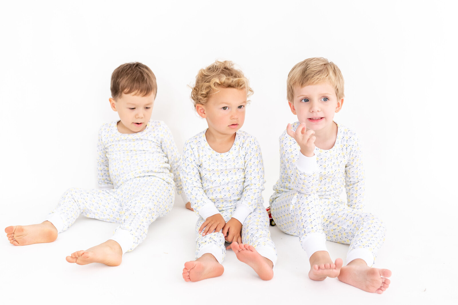 Three little boys wearing pjs