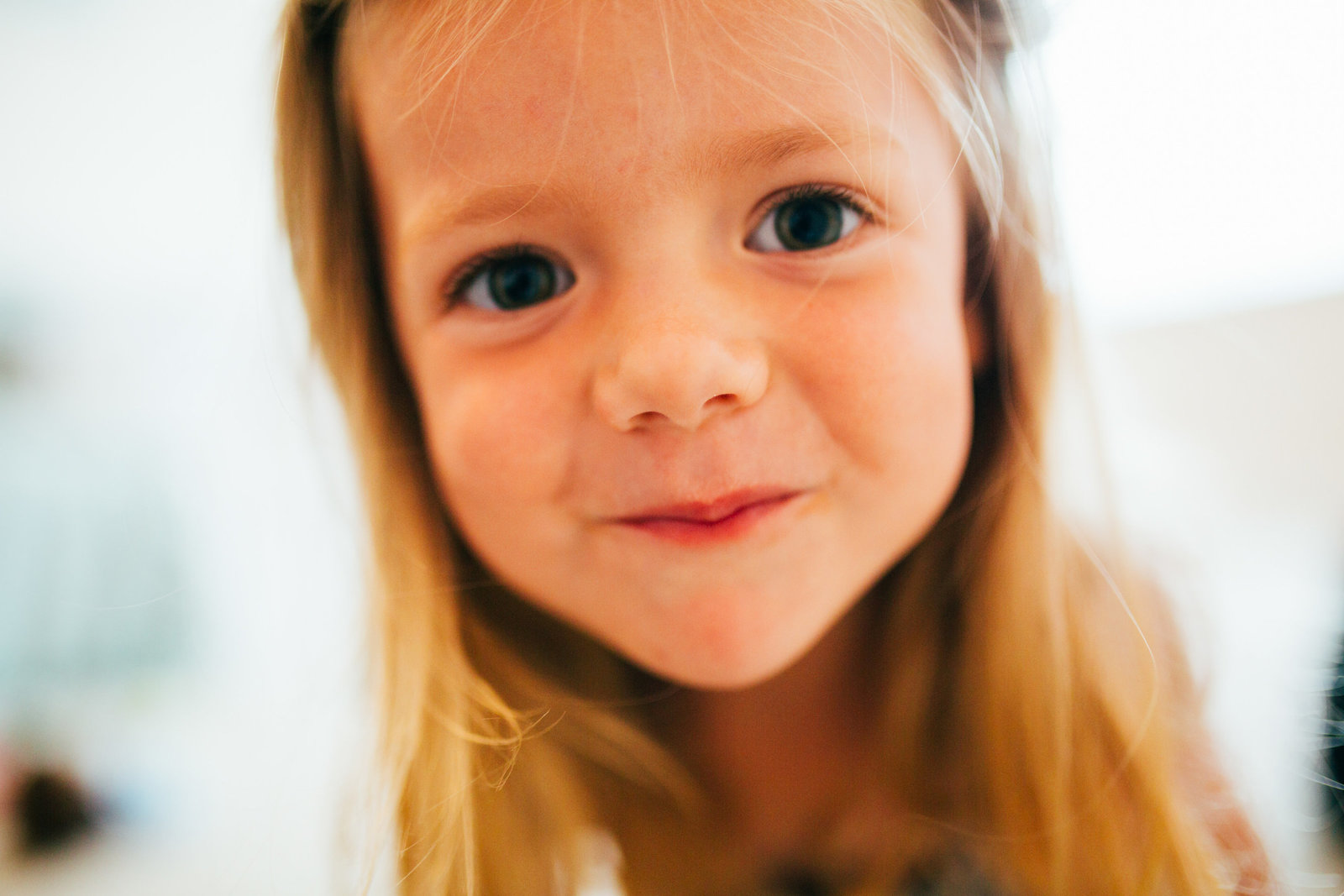 Smiling relaxed natural little girl photograph