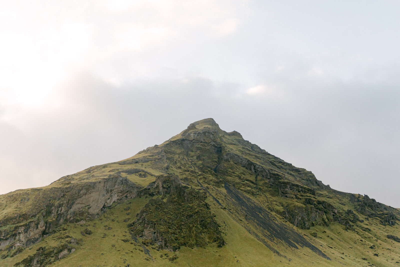 iceland mountain with green and rock