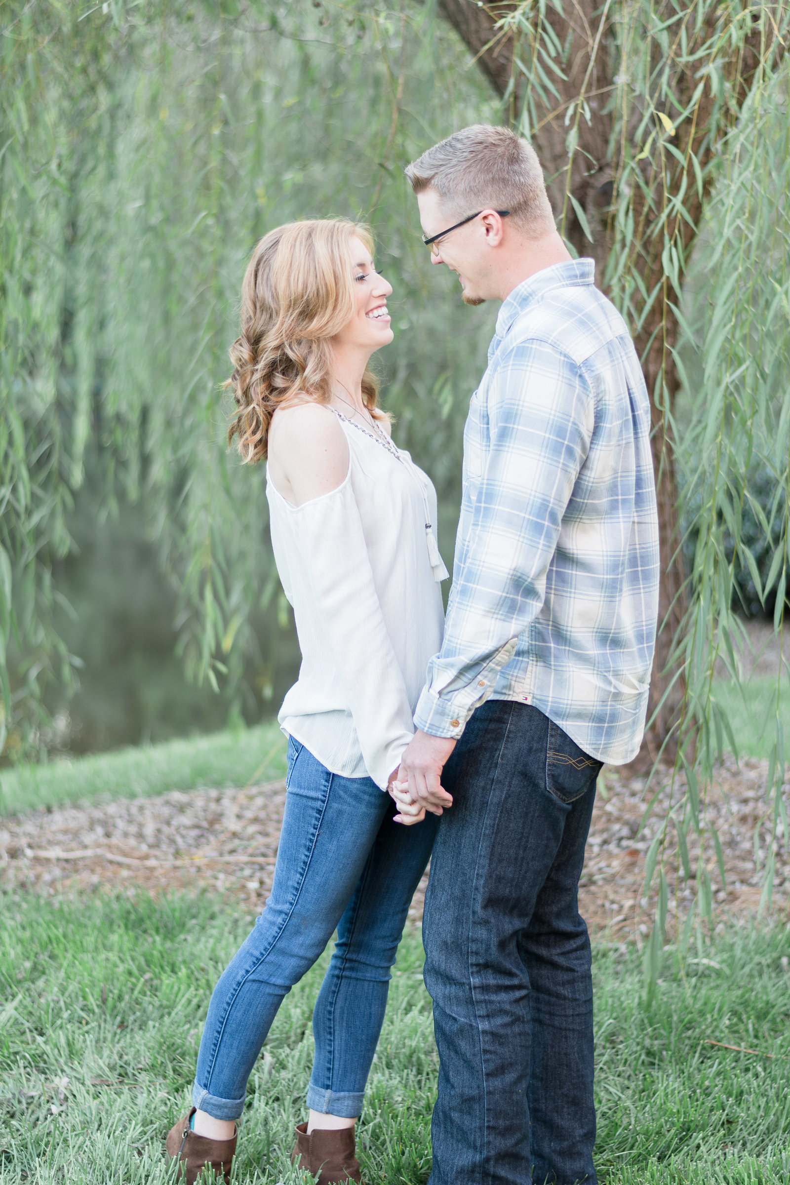 Charlotte engagement photographer shot of  couple in willow trees in south park