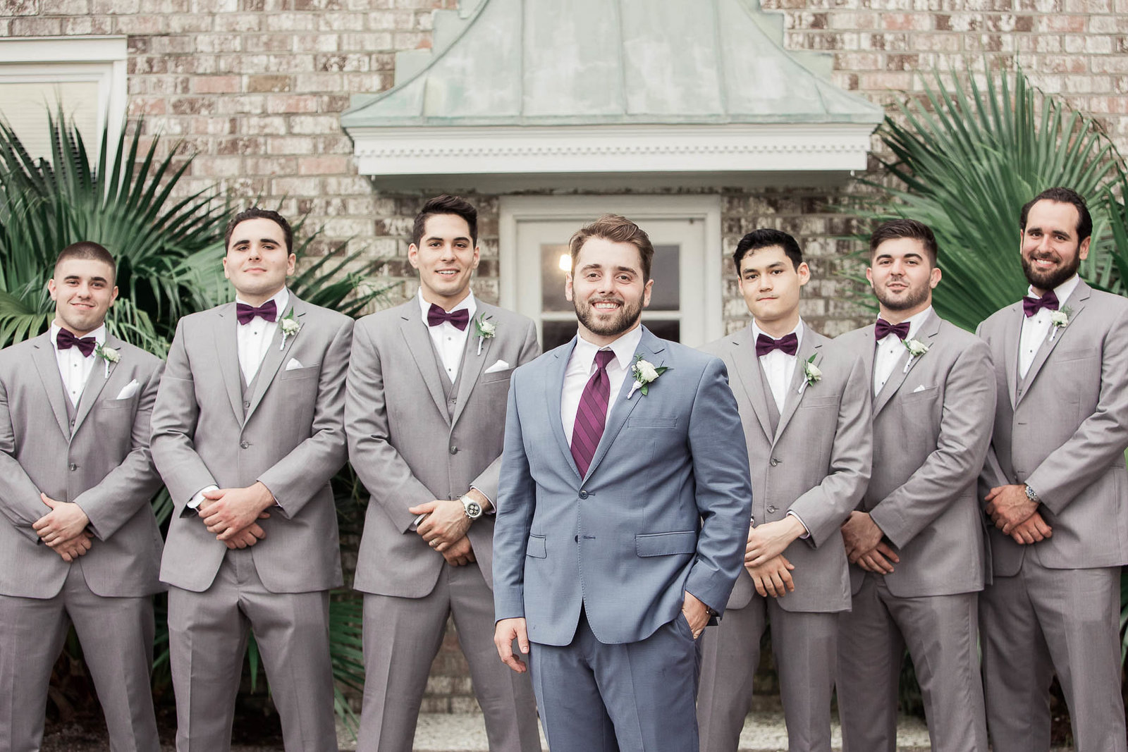 Groom poses with groomsmen, The Island House, Charleston, South Carolina