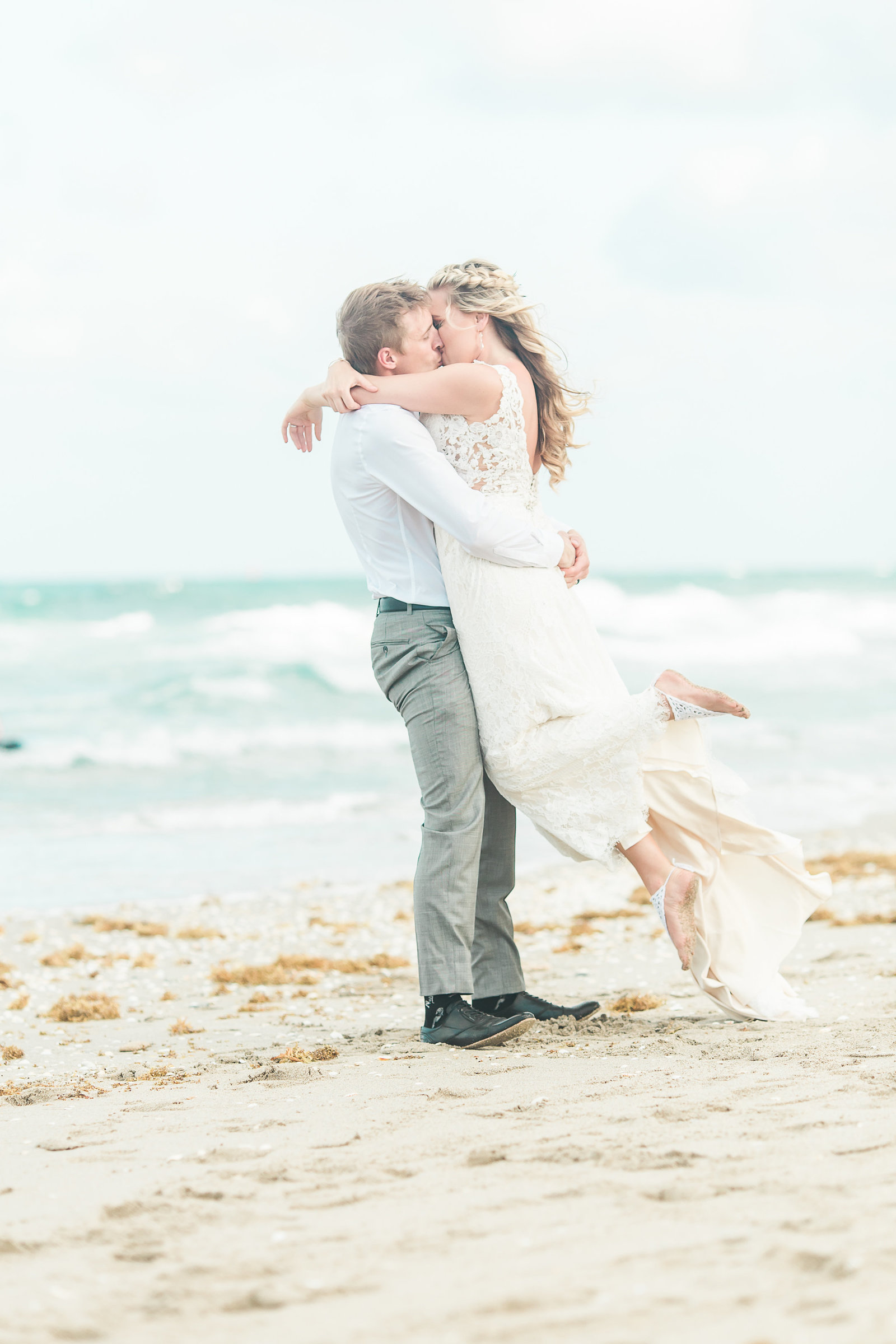 Beach Kiss Wedding Couple- Hilton Singer Island Wedding - Palm Beach Wedding Photography by Palm Beach Photography, Inc.