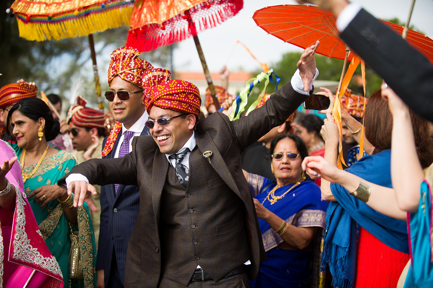 Family of the groom celebrates during the Baraat