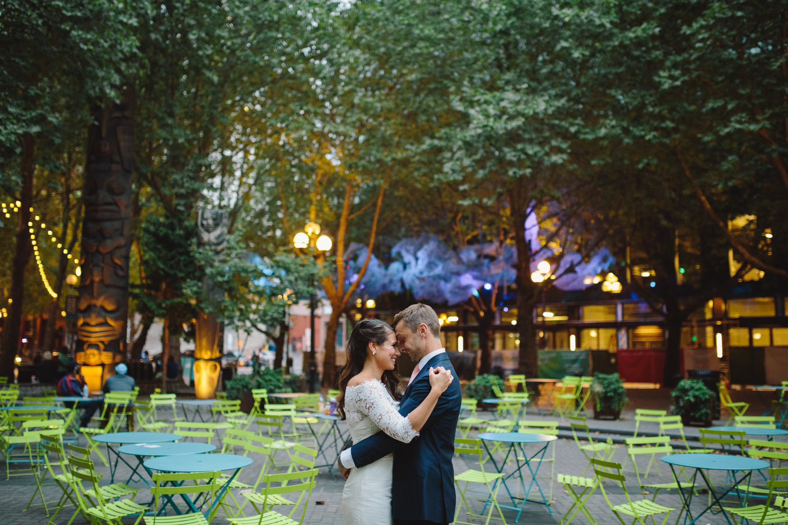 Bride and groom touching foreheads in Occidental Park