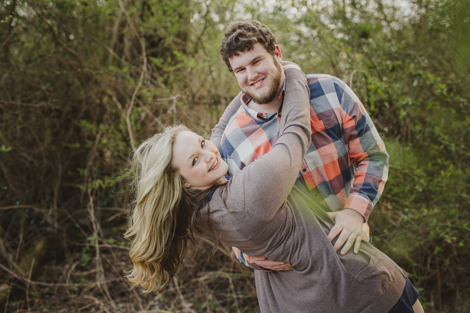 Nathan and Emily dance during their engagement session at Meadow Hill Farm in Columbia, Tennessee.