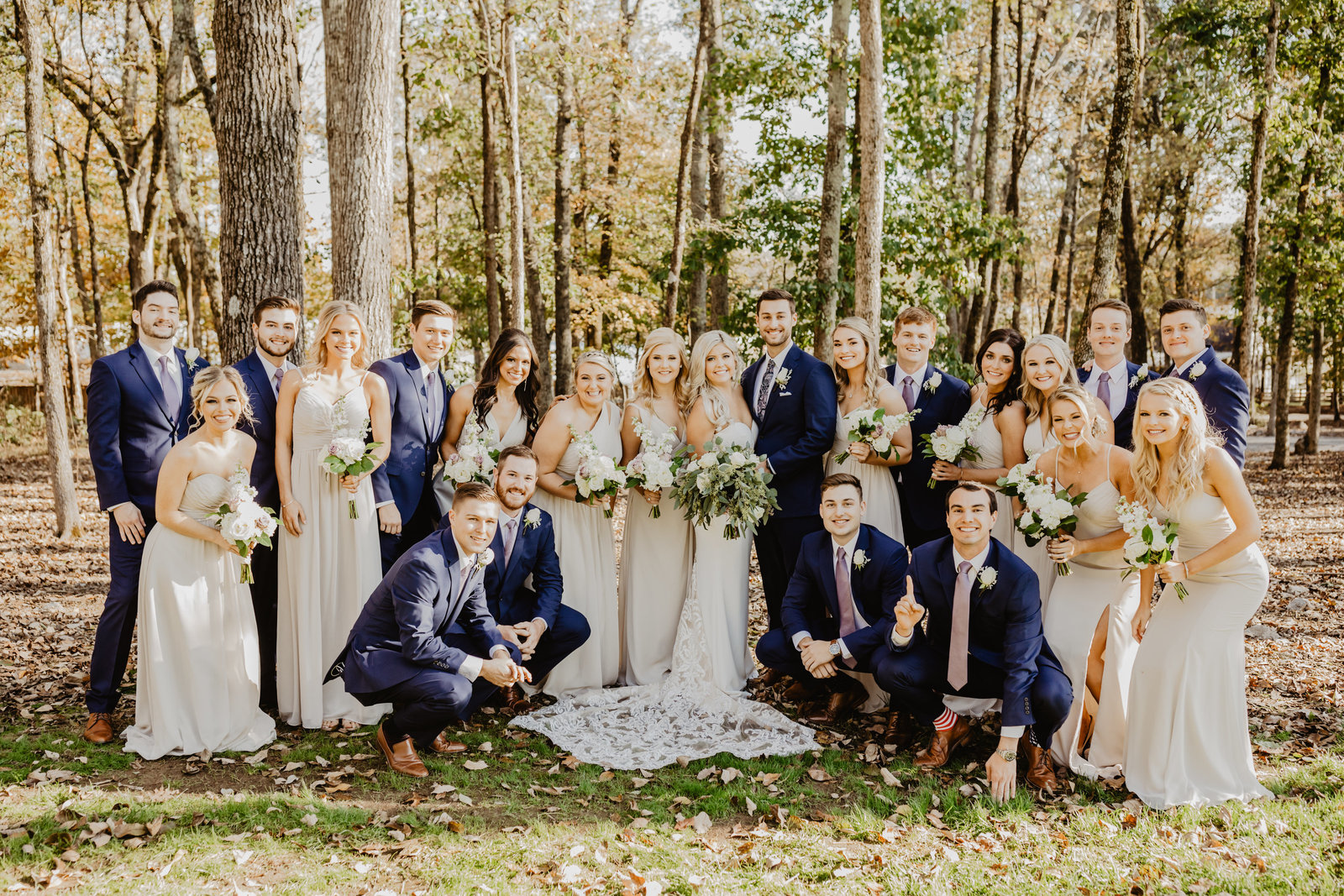 Full Bridal Party surrounds Bride and Groom at Saddle Woods Farm