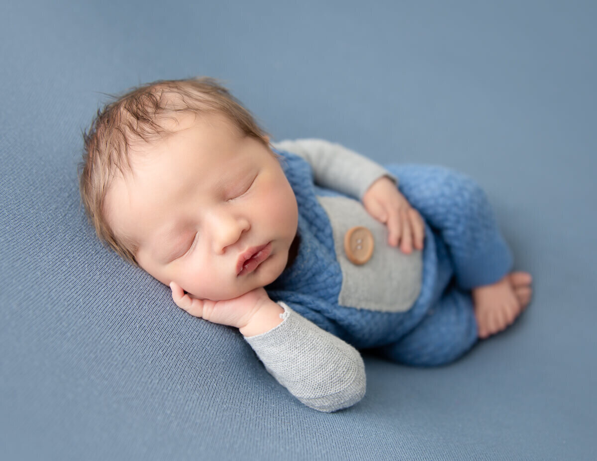 Precious newborn boy at our in-home studio in Rochester, NY.