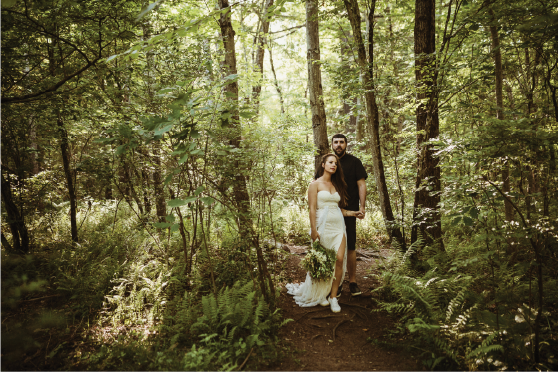 couple-walking-through-forest@2x