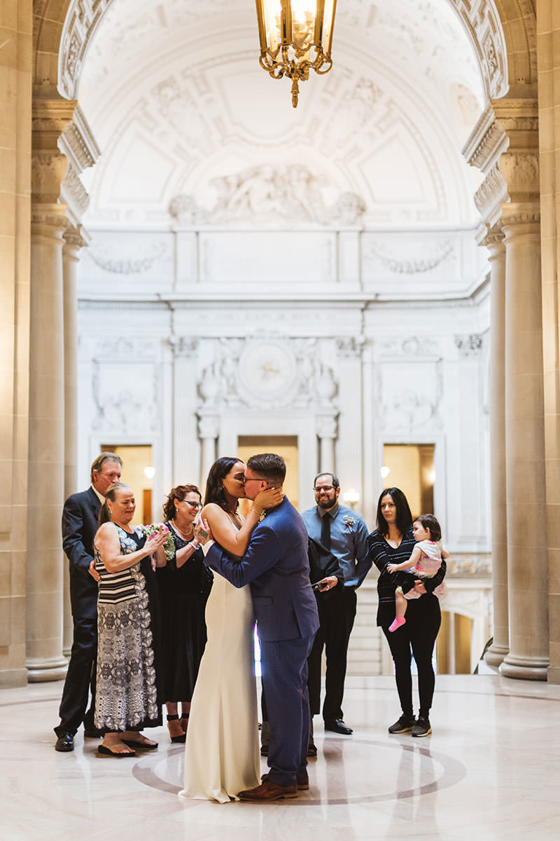 first kiss at rotunda ceremony with family cheering