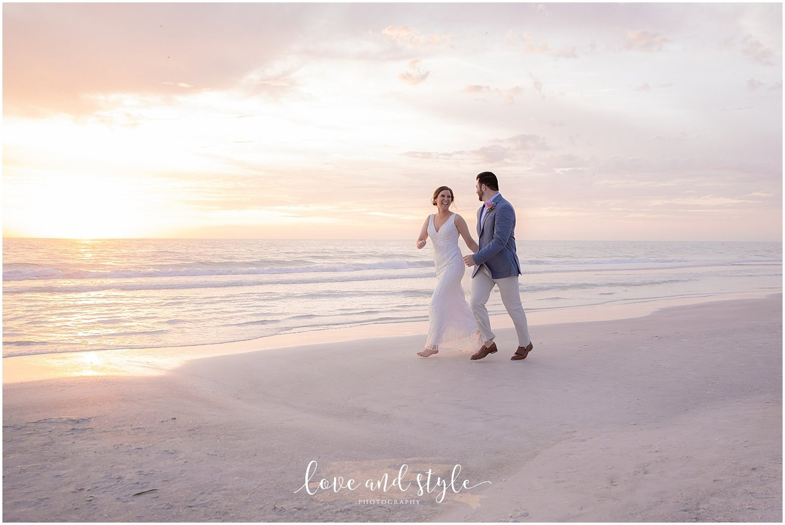 Bride and Groom walking on Bradenton Beach at The Sandbar on Anna Maria Island