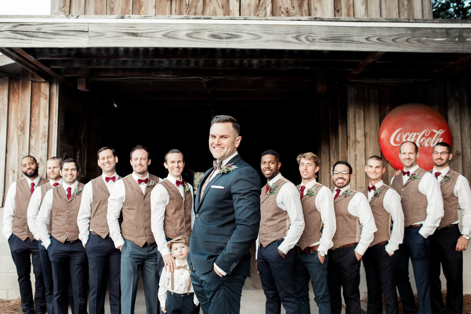 Groom poses with groomsmen, Boals Farm, Charleston, South Carolina. Kate Timbers Photography.