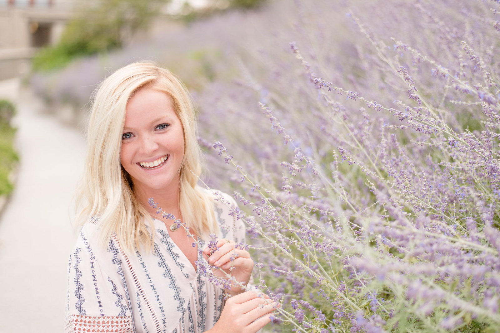 Girl holds lavender and smiles