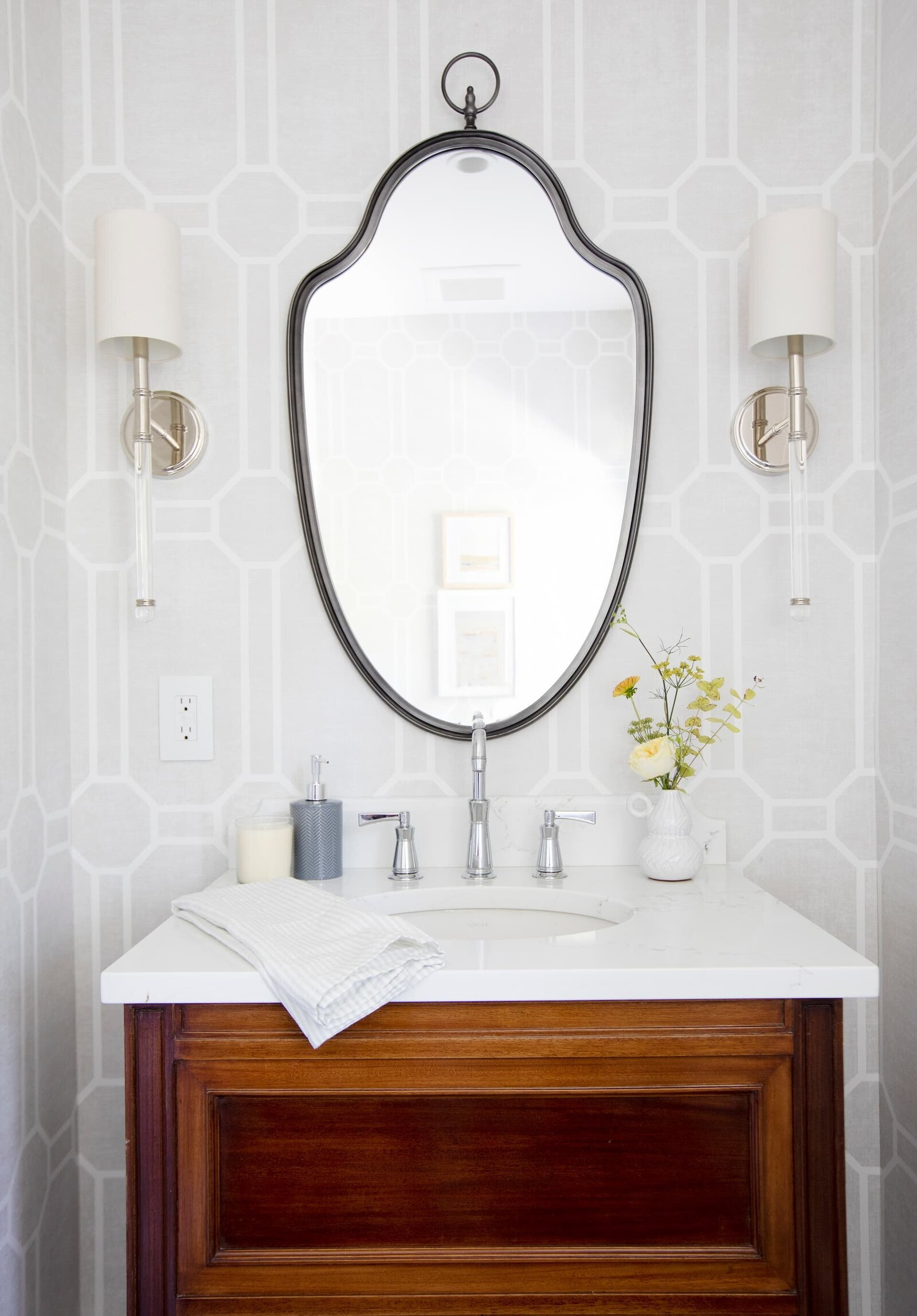 Granville Street l Powder Room with Trellis Wallpaper l Vintage Vanity with Black Mirror and pair of Lucite Wall Sconces