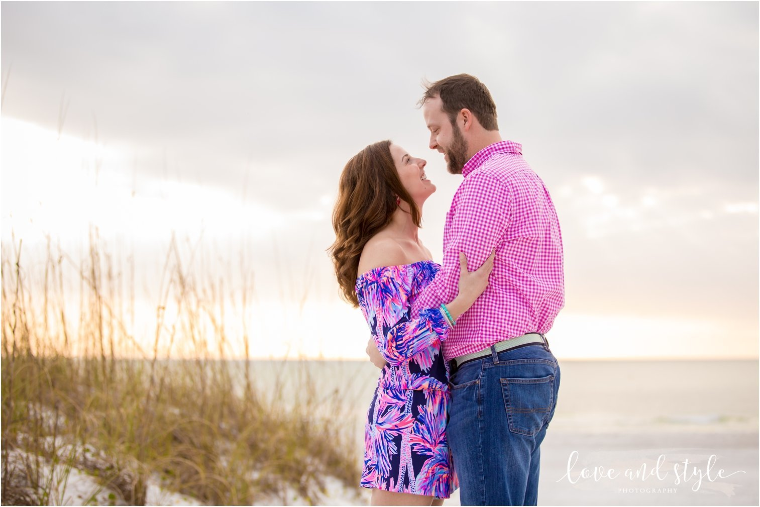Engagement Photography on Coquina Beach at Sunset with couple embracing on Anna Maria Island