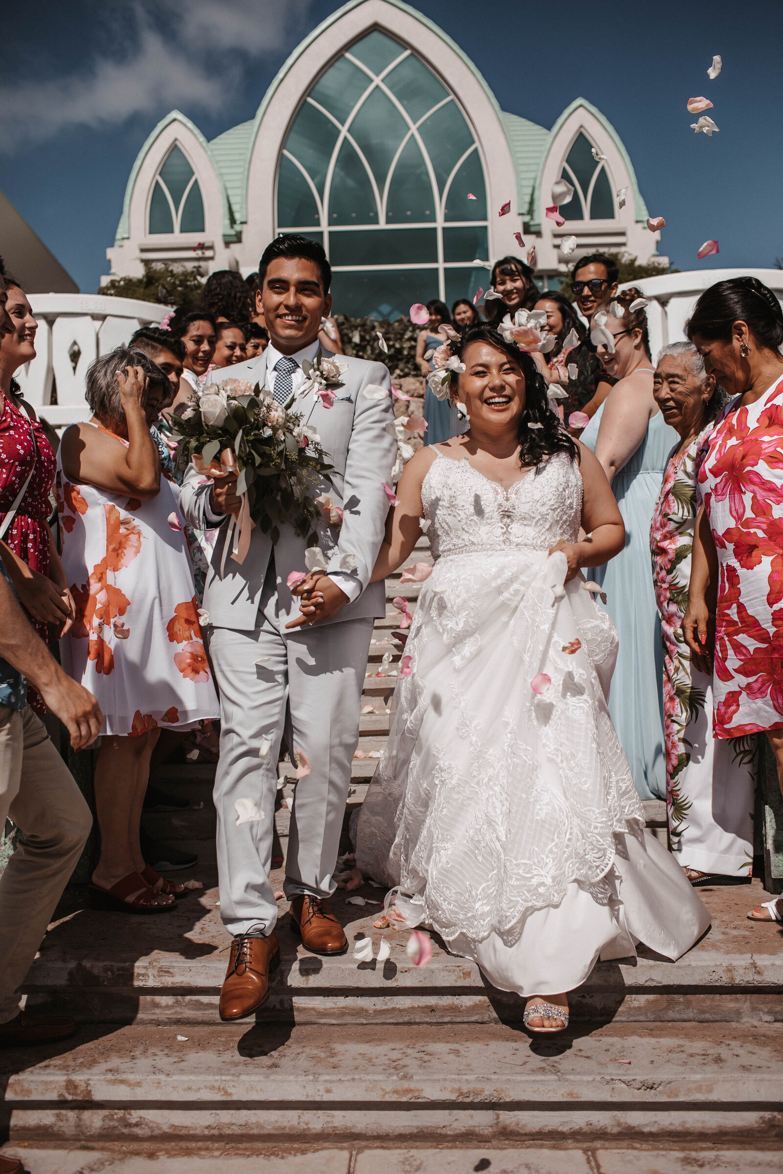 bride-and-groom-walking-throuh-friends-and-family-flower-toss