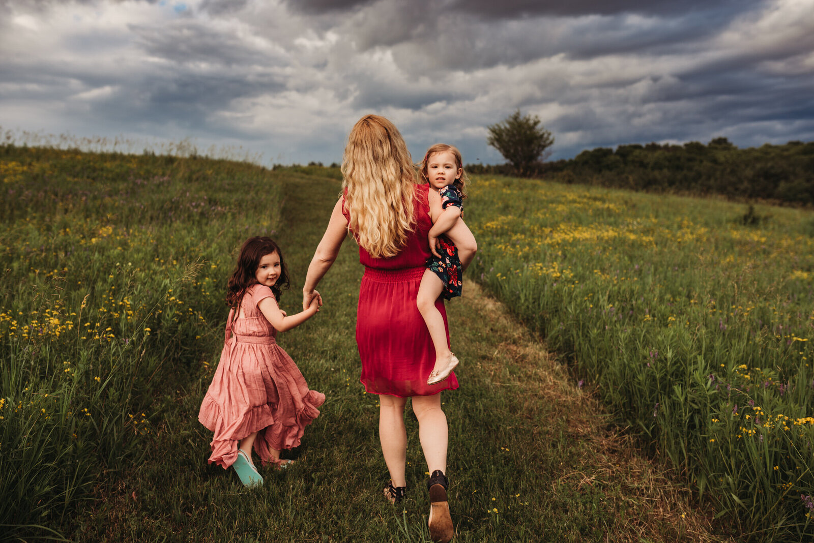 Mother and her two young daughters walking up a hill at Country Cut Flowers