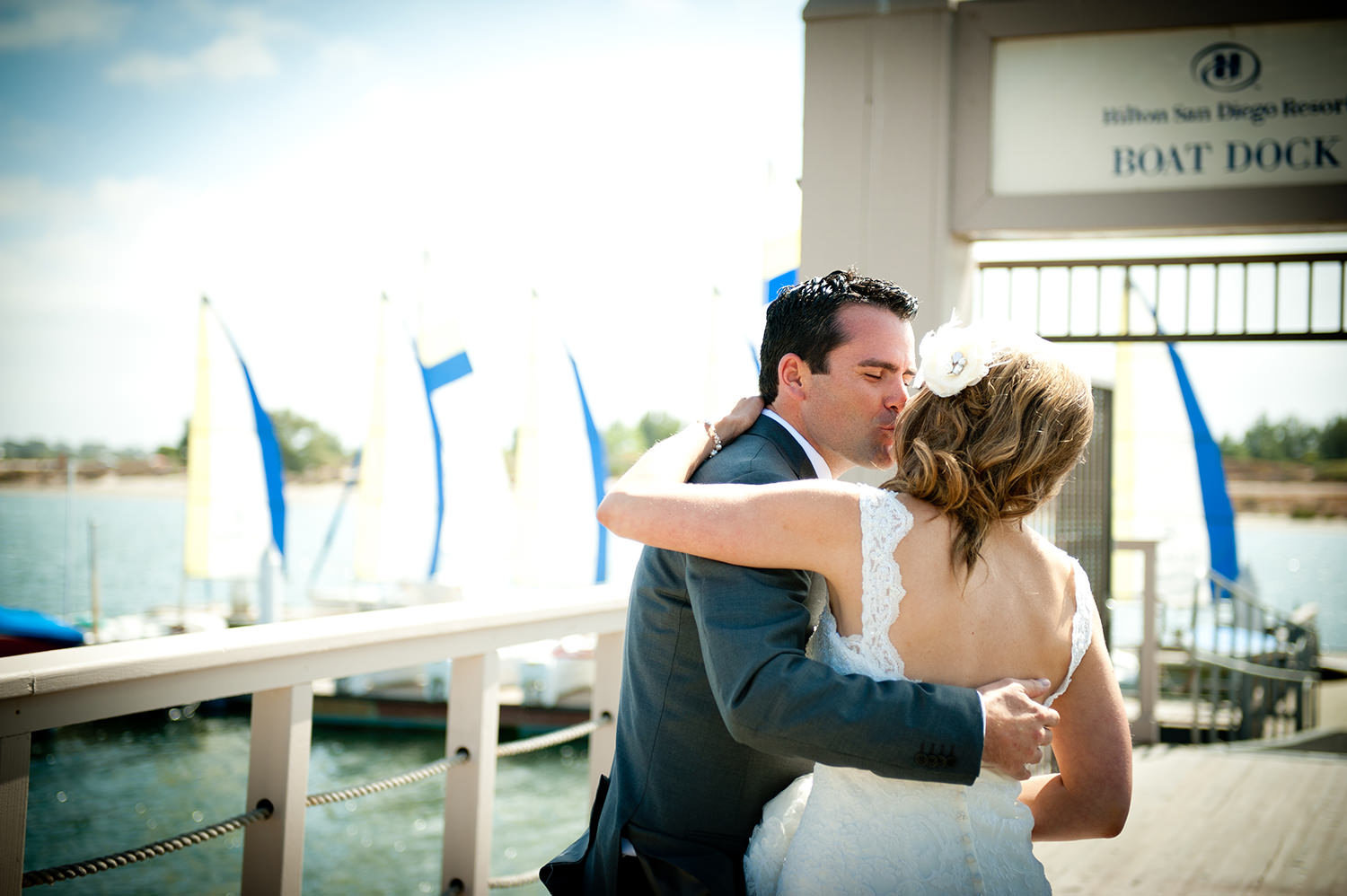 bride and groom on bay dock hilton mission bay