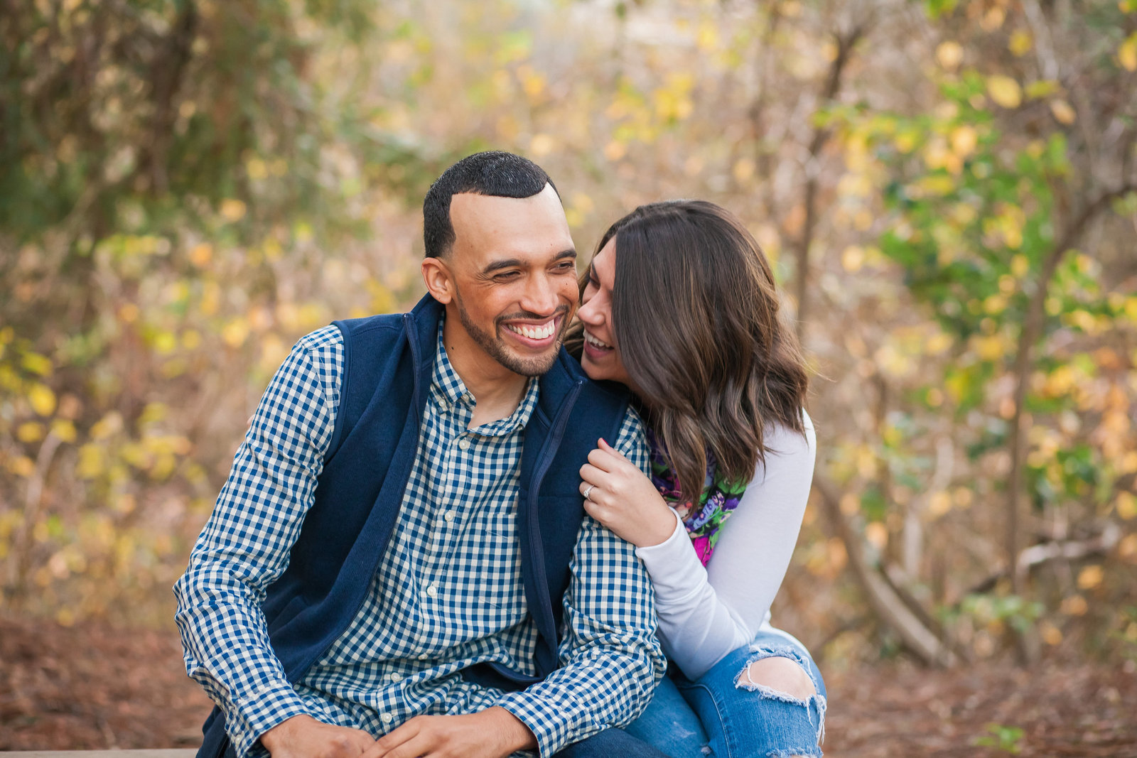 UC Davis Arboretum engagement couple snuggling and laughing