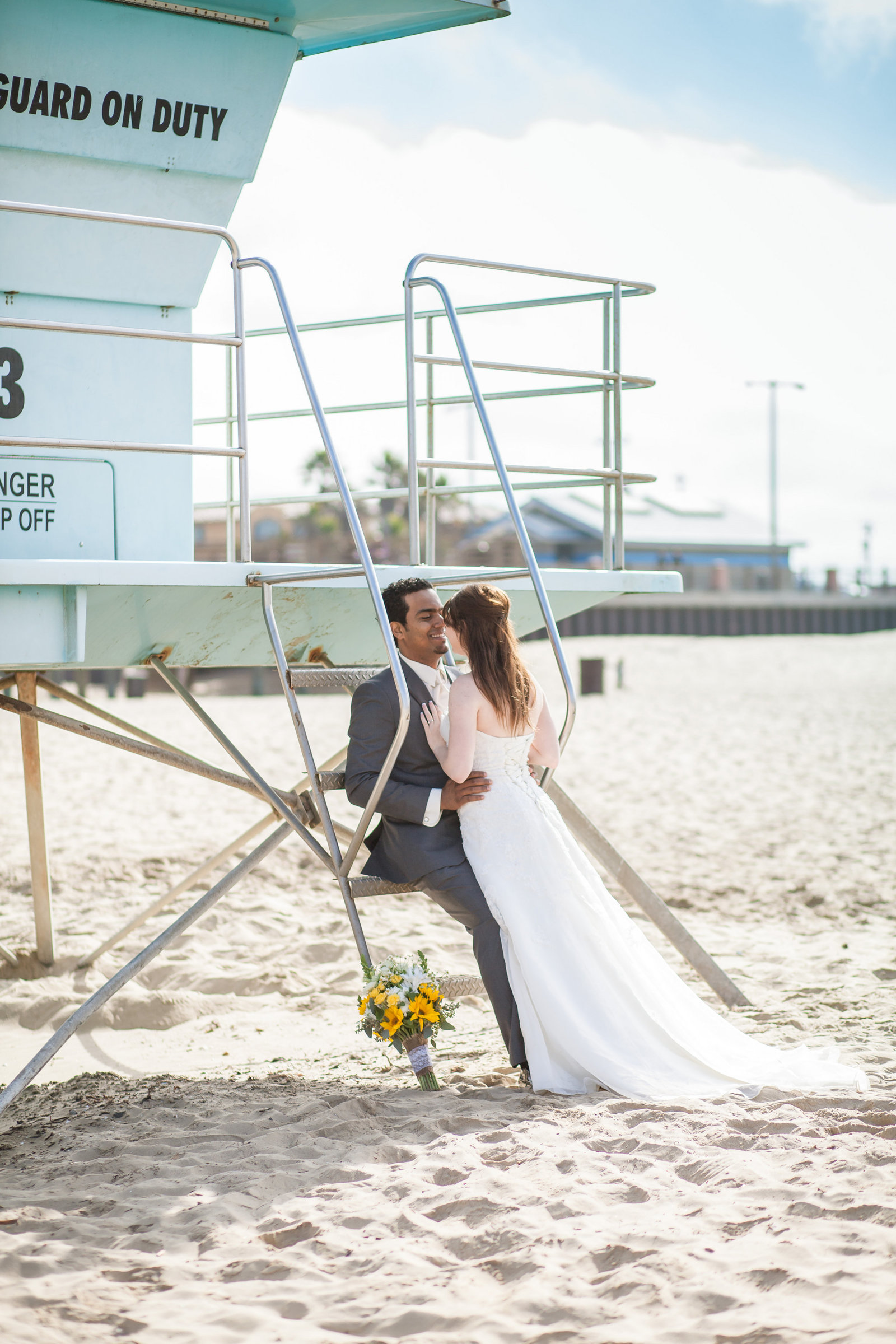Pismo Beach Bride and Groom at lifeguard tower