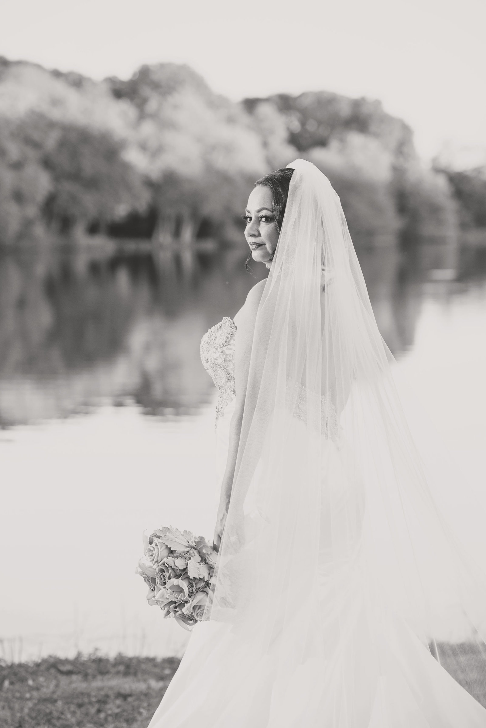 Bride facing water at Camp Pa-Qua-Tuck