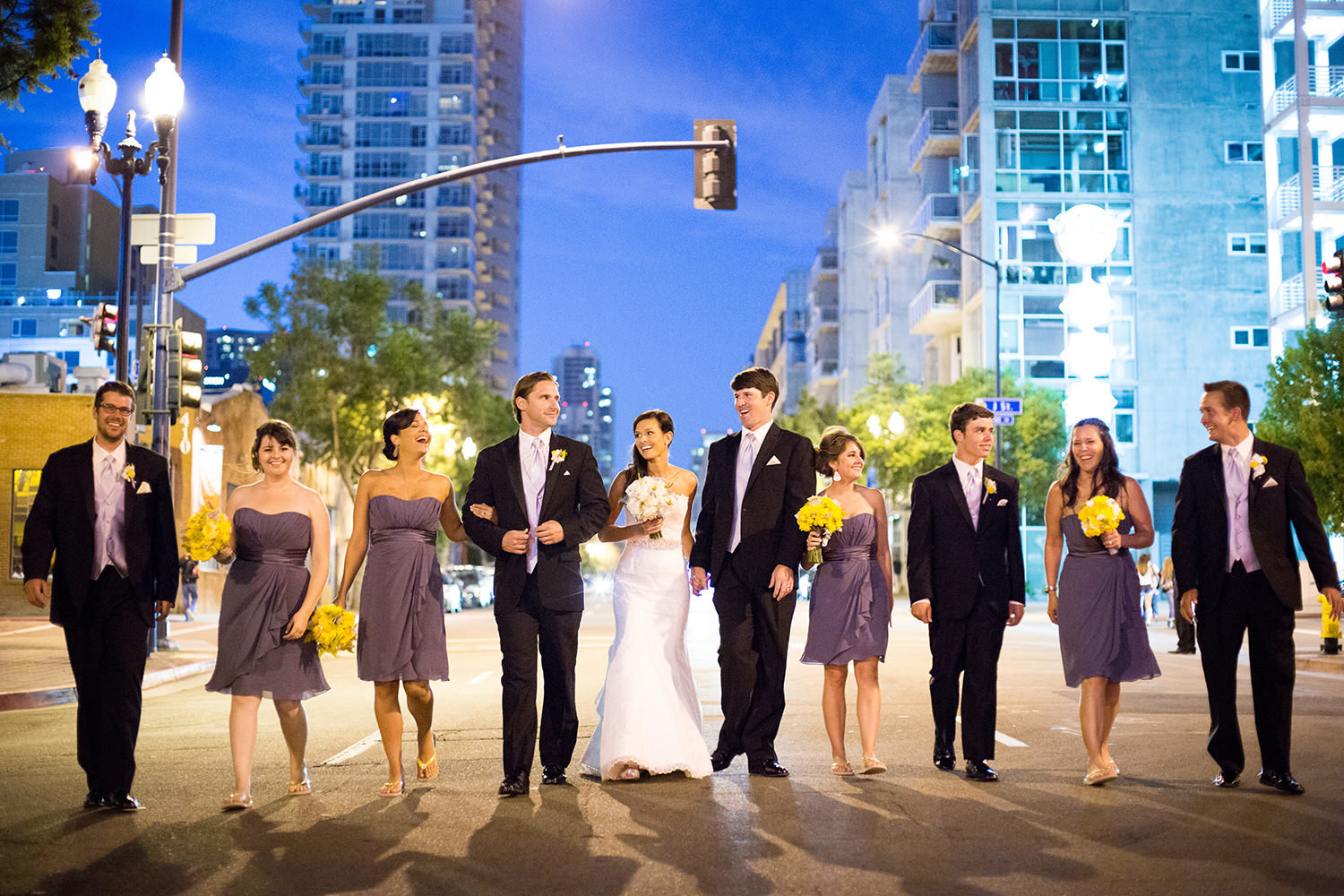 Creative wedding party portrait downtown at night