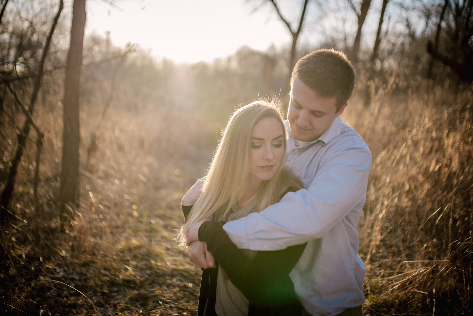 couple in romantic pose at golden hour