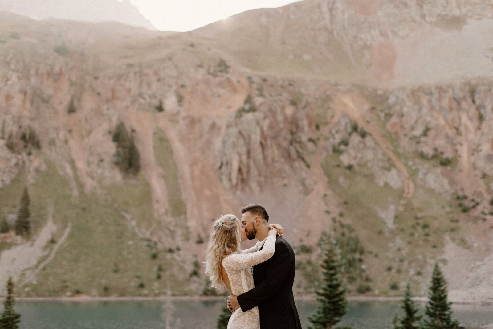 couple kissing at mountain elopement in valley