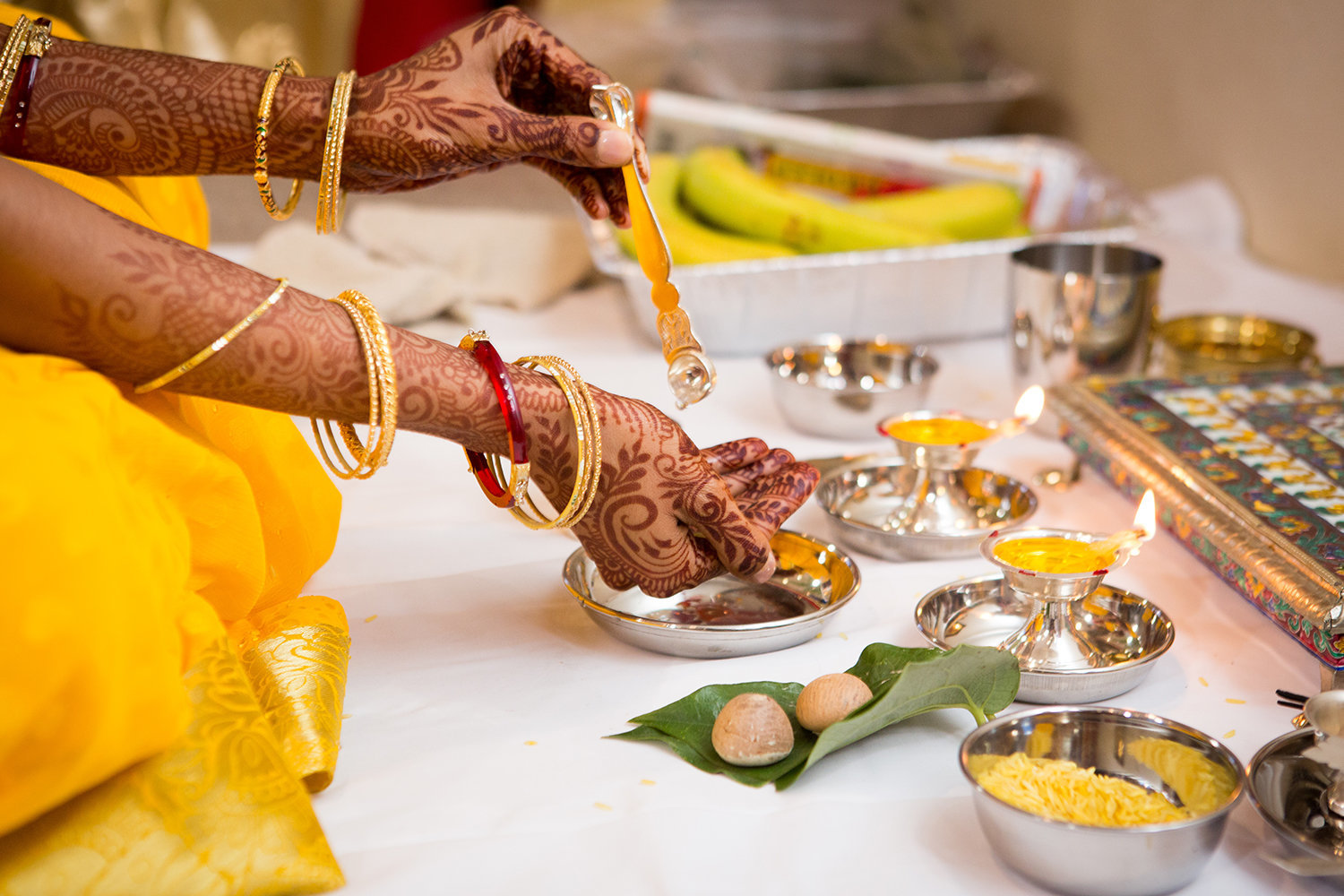 Close up of a Hindu Indian bride's hands during a wedding ceremony