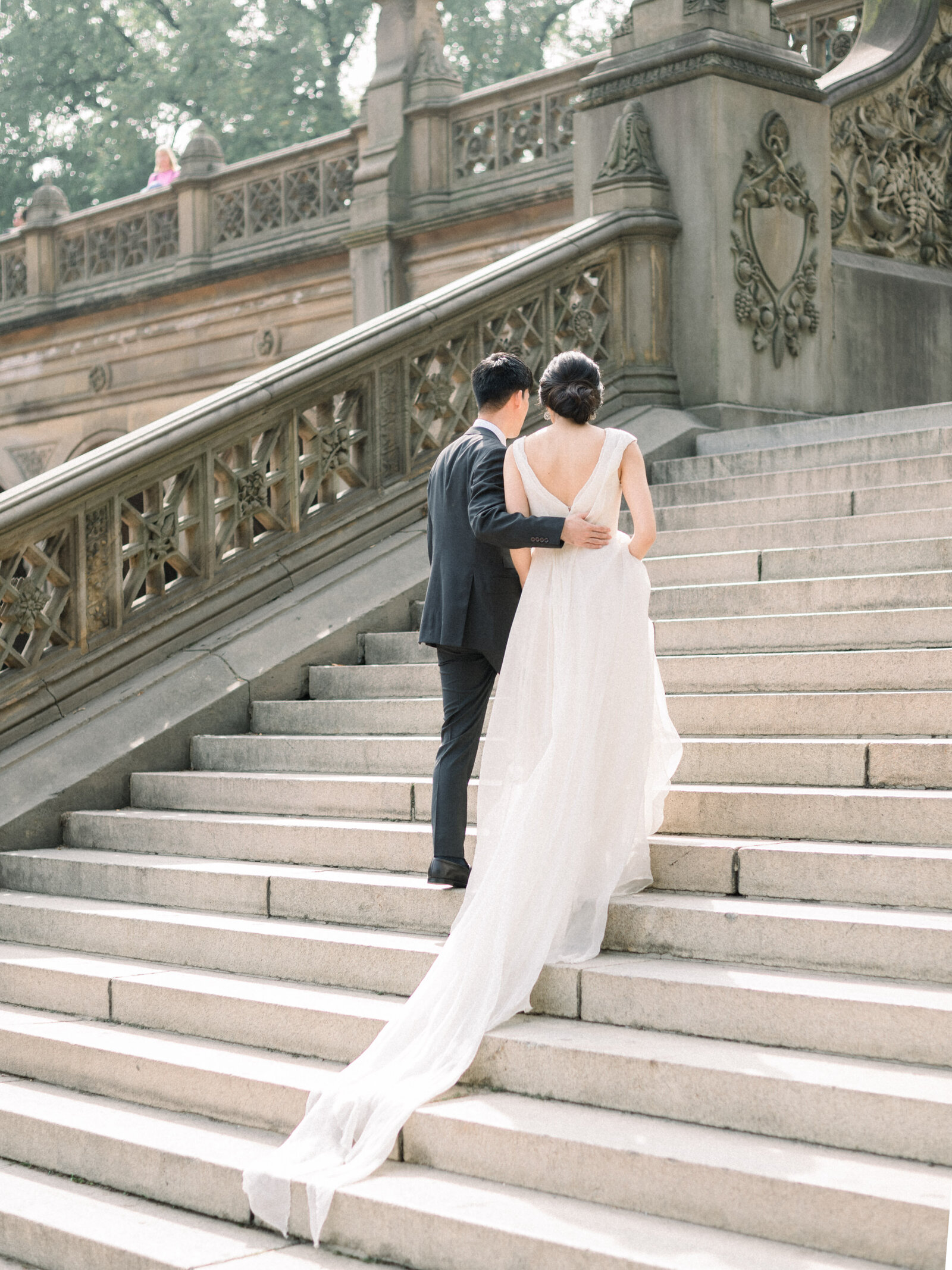 Bride wears Carol Hannah and shares a moment with groom on stairs at Bethesda Terrace in Central Park NYC
