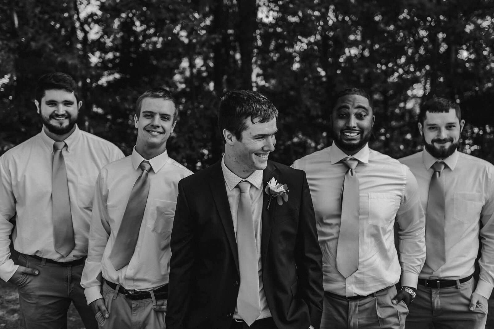 J.Michelle Photography photographs groom and best men laughing