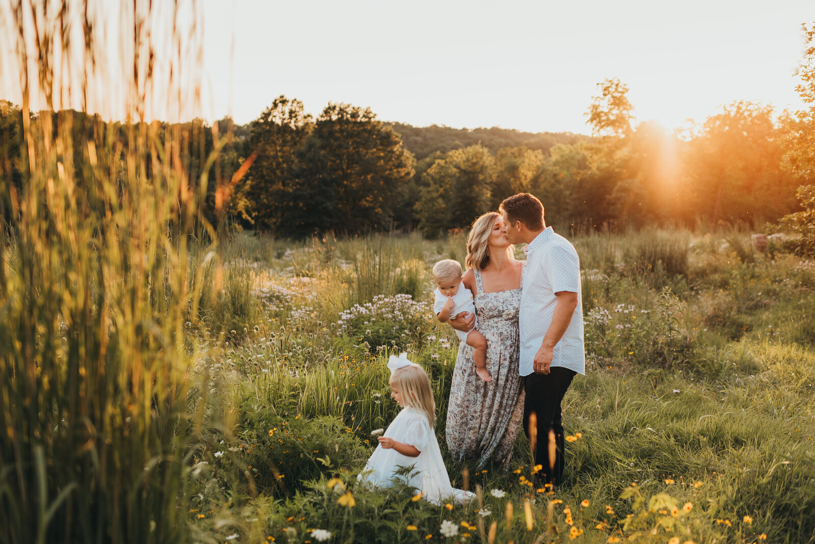 Sunset family photography session couple kissing