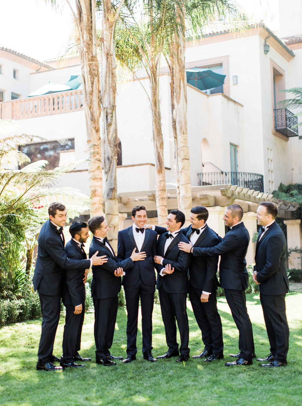 Groom and groomsmen in tuxedos for wedding party photo at Butterfly Lane Estate