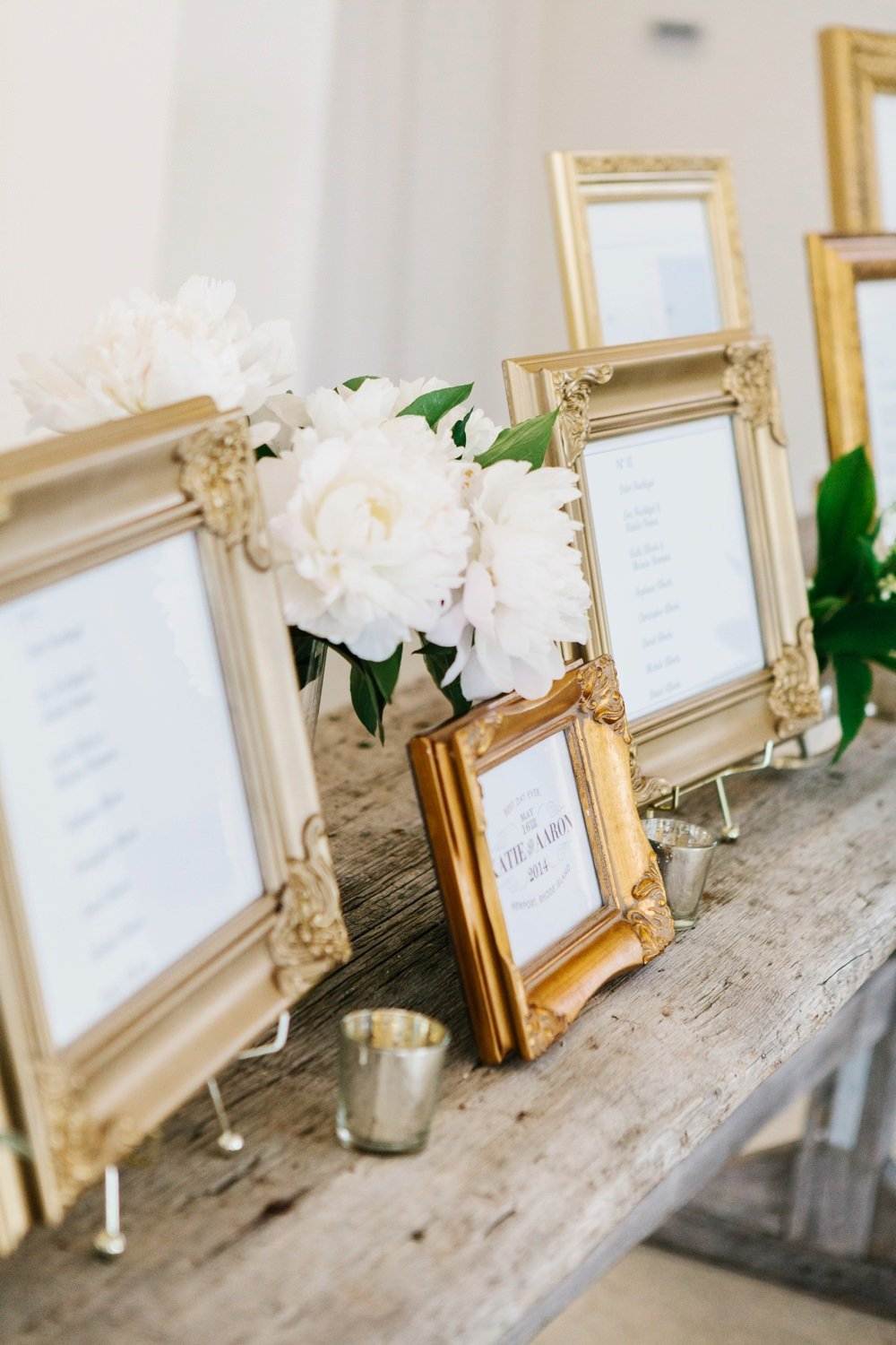 Modern escort card display in gold frames at Belle Mer in Newport, RI