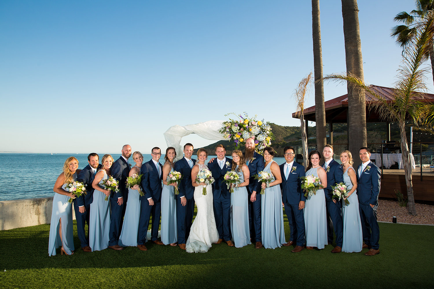 bridal party at ocean view room blue dresses