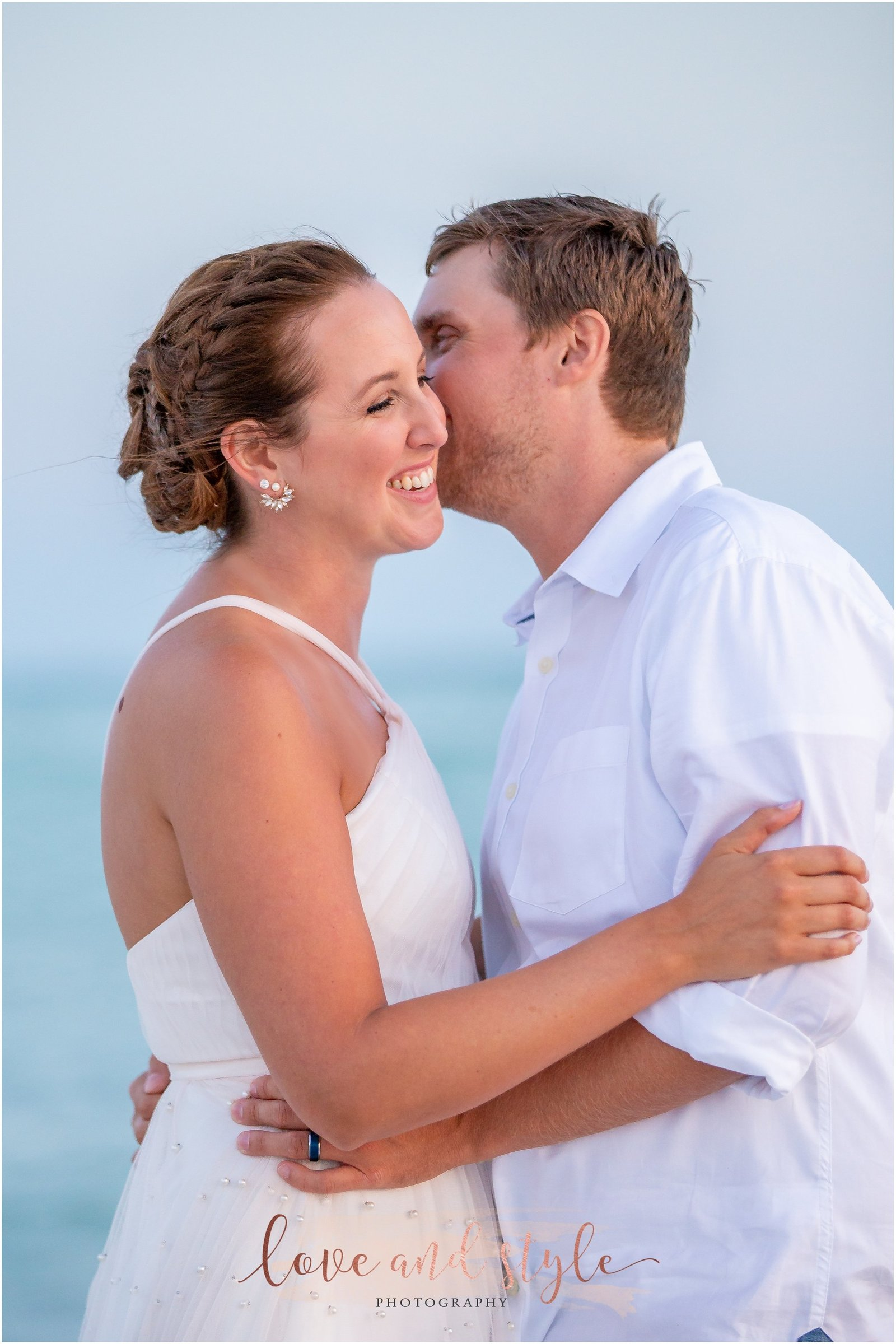 Lido Beach Wedding Photography of bride and groom laughing together on the beach