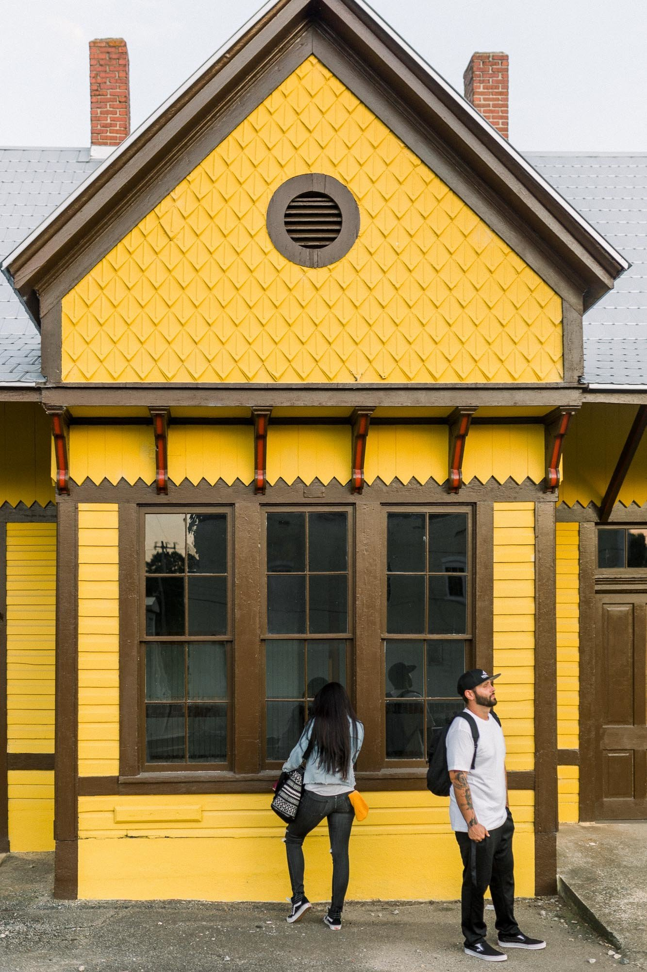Engagement session in yellow train station captured by Staci Addison Photography