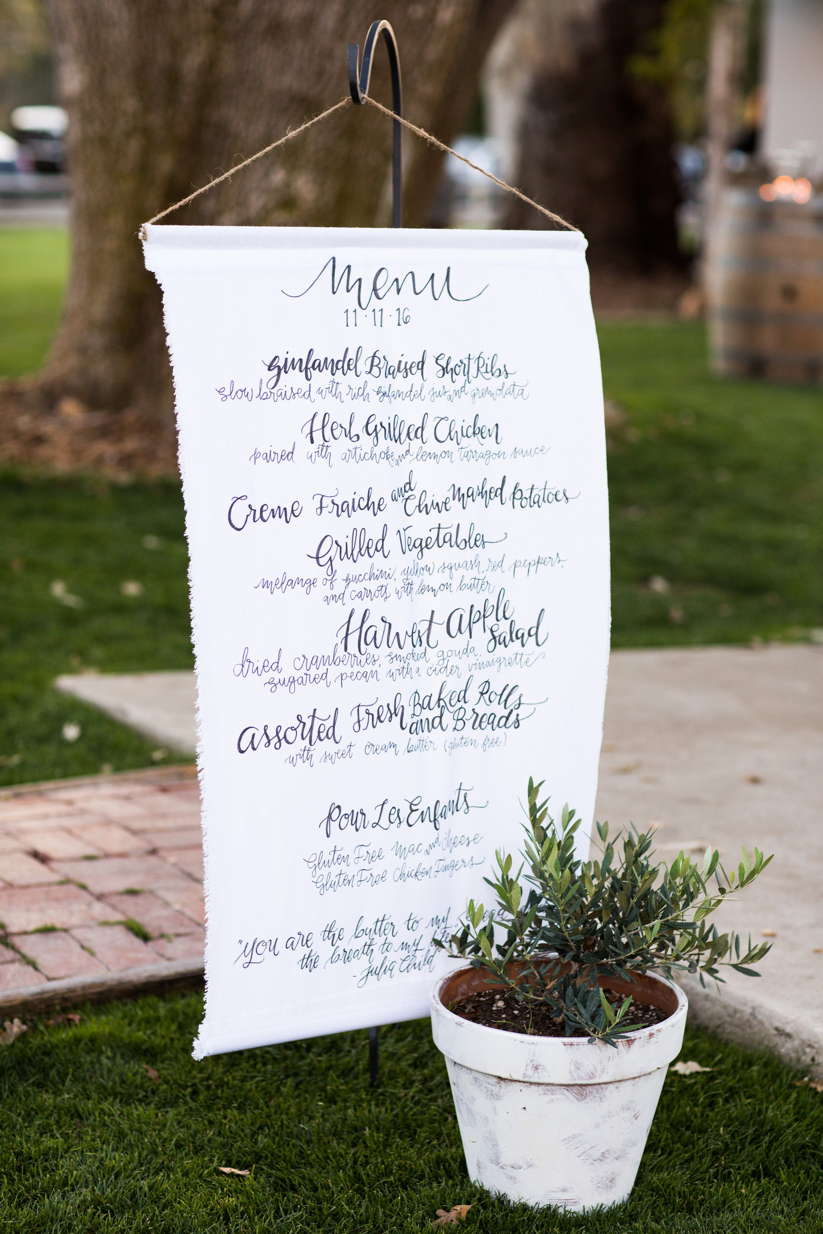 linen hanging banner for menu or other wedding signage during wedding reception