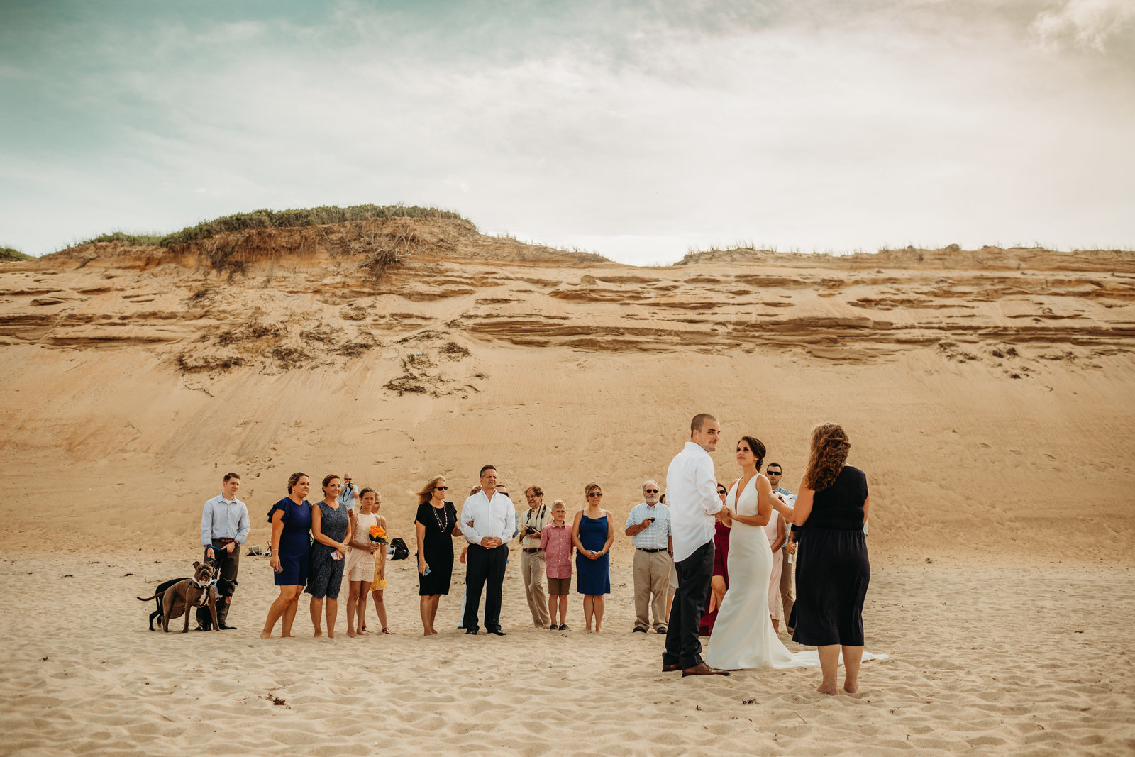 bride and groom get married in intimate beach ceremony on cape cod