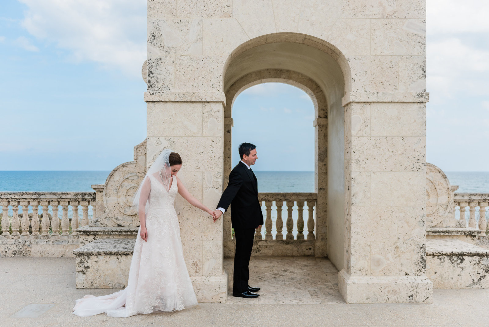 A no look first look at the worth Ave clock tower at a Palm Beach wedding