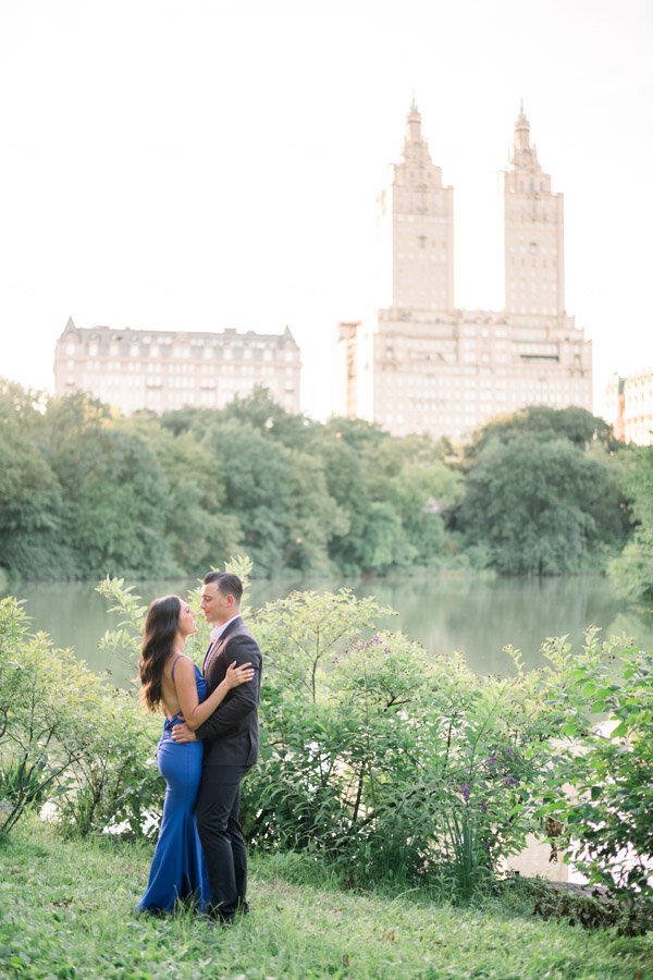 Stylish bride and groom to be pose for engagement session in Central Park NYC