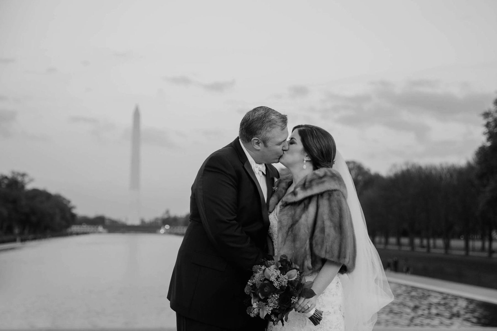 Bride and groom stand together, Washington Monument, National Mall, DC