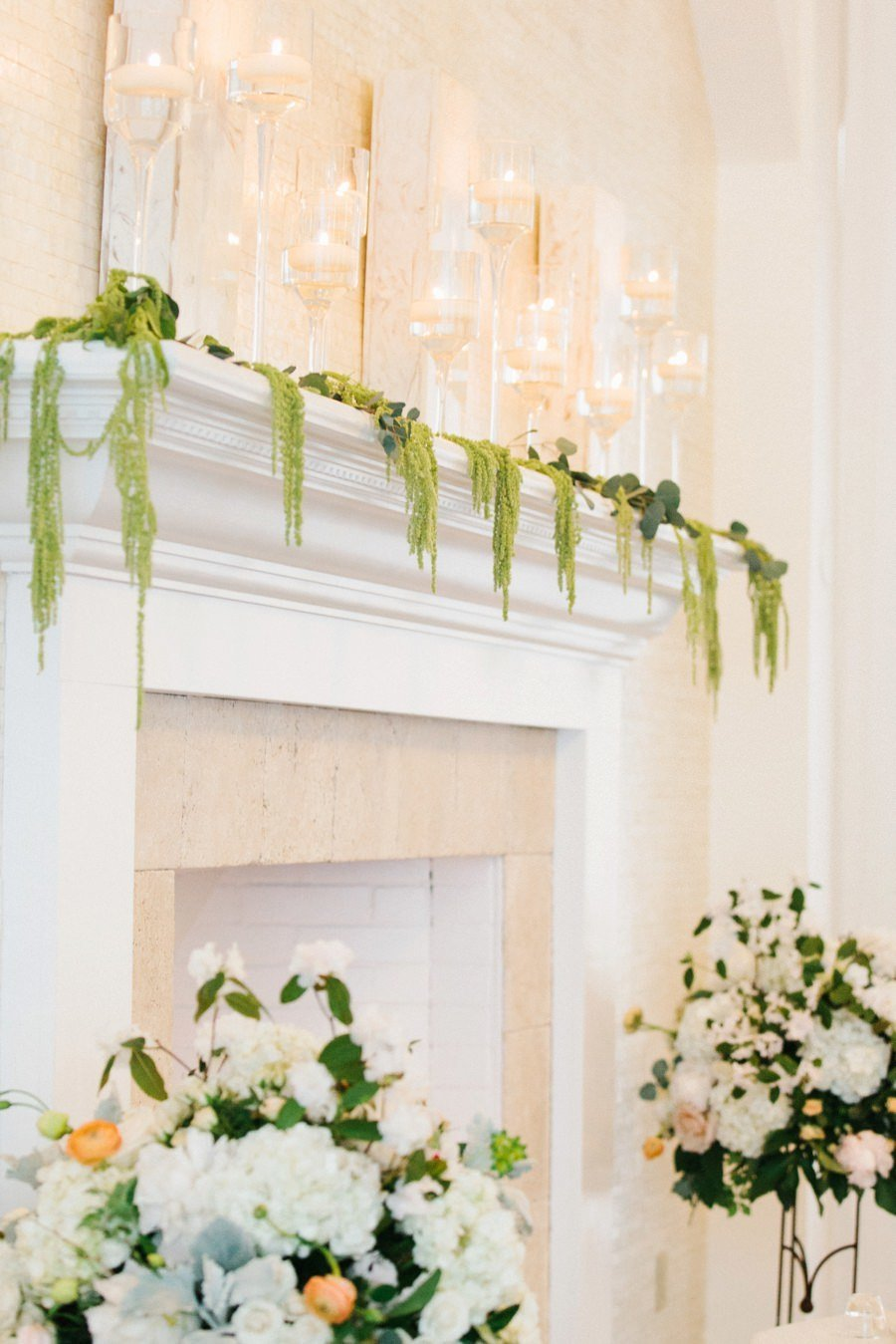 Indoor wedding ceremony fireplace decor for wedding at Belle Mer in Newport, RI